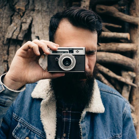 man with camera 540x540 - Builder Elements