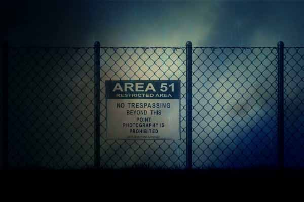 area 51 sign on a metal fence on a stormy night n5ge8srie  F0006 600x400